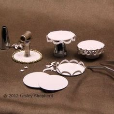 Assembling cake stands for a dollhouse made from punched photo paper and beads. - Photo © 2012 Lesley Shepherd