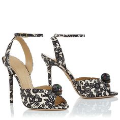 SOPHIA by Charlotte Olympia. Sophia's lady-like sandal silhouette is given a macabre twist with its black 'Papel Picado' print and hand painted skull detail. This look is perfect for the dark-humoured fashionista.