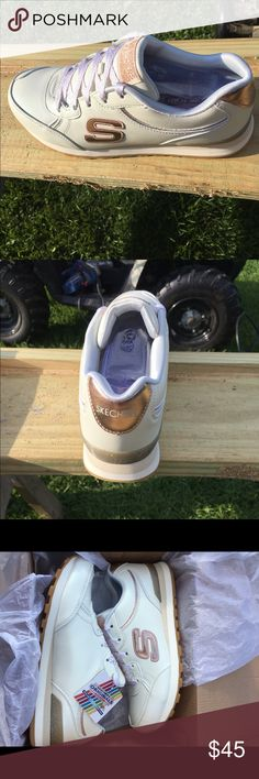 Skechers OG 82 Shimmer shoes Brand new in the box! Skechers OG 82 Shimmer shoes with air-cooled memory foam. White with gold shimmer accents. Never been worn. Size 8 Skechers Shoes Athletic Shoes