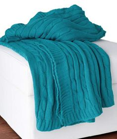 """Pinspiration: I can totally make a gorgeous teal cable-knit throw like this, with warmer yarn. ... I just used the neologism """"Pinspiration,"""" didn't I. Ugh."""
