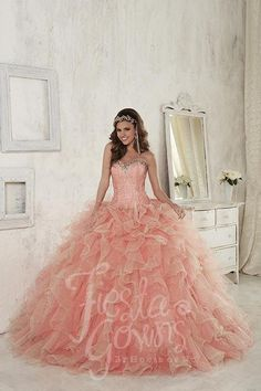 Dress in this outstanding ball gown with embroidered corset, lace-up back, sweetheart neckline, and ruffled, two-tone organza, half with sparkle. Download the Fiesta Gowns by House of Wu sizing chart