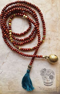 Wood Lariat Mala with cowbell charm and teal tassel.