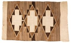 Navajo-style rug with geometric design in brown and beige, circa 1920.