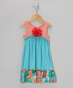 This dress' rosette embellishment and contrasting chiffon trim make for a nifty quick getup that leaves little ones dressed to impress.
