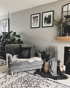 This is a great example of how to implement layering. The chair looks super cosy with the sheepskin and cushion, the rug adds another touch of texture and the plants bring the space alive. The grey wall has a warm undertone to it, which ties in nicely. Living Room Grey, Home Living Room, Living Room Designs, Cosy Living Room Decor, Cosy Decor, Cosy Bedroom, Living Room Inspiration, Home Decor Inspiration, Monday Inspiration