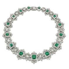 AN IMPORTANT EMERALD AND DIAMOND NECKLACE, CARTIER Designed as a graduated series of step-cut emeralds within scalloped frames of circular- and single-cut diamonds interspersed with foliate links each centring on a navette-shaped diamond, signed Cartier Paris made in France and numbered, French assay and maker's marks, length approximately 410mm detachable into three sections of approximately 225mm, 90mm and 80mm respectively, fitted case by CARTIER LONDON