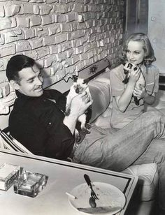 Clark Gable & Carole Lombard at home with their kittys.