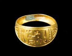 """This is a golden ring inscribed with Hittite Luffic Hieroglyphic script. It reads: """"The free woman."""" Syria, 2000-1000 B.C."""