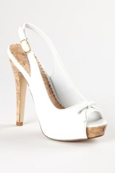 white platform with peep toe, slingback, bow at vamp .... LOVE these heels