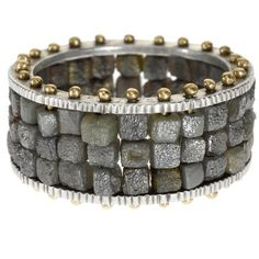 Todd Reed, my new favorite fine jewelry maker.  Item trdr200  This is considered a mans ring, but I luv it and would definitely wear it. 18ky gold with sterling silver and raw diamond cubes. Todd Reed's jewelry rocks!  http://www.toddreed.com