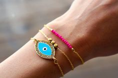 Great combo! Simple, colorful, and stylish. Turkish Evil Eye on Gold Gold Chain Bracelet