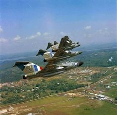 Formation of Gloster Javelin FAW.9 aircraft of No. 64 Squadron RAF flying over the Singaporean countryside, 1968.