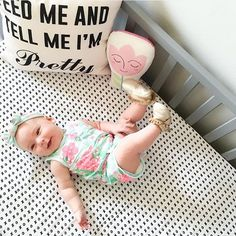 Have you ever seen a cuter crib sheet or a happier little girl?! If only we were all this happy after waking up!   Modern Burlap's XO organic cotton muslin Crib Sheet must be the answer to happy dreams!