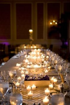I love the twinkling and romantic effect of a ton of tiny candles glittering along a table. Simple and beautiful. One of my favorite ways to dress a table at an event.