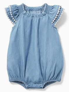 Adorable chambray bubble romper with pom-pom trim #babygirlclothes #bubblerompers #babygirlspringtrends #babygirlsummertrends #ad
