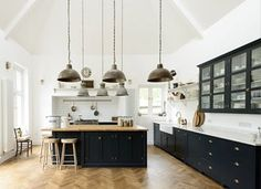 It's no secret that blue colorways are trending for kitchens, and with good reason: They add depth and dimension while playing well with stark white and other neutral tones. Here, ten navy blue looks we're absolutely loving. Get even more inspiration by heading to our home decor Pinterest board . RELATED: 6 Kitchen Design Trends That Will Be Huge in 2017