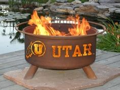 University of Utah Collegiate Fire Pit / Grill. Saw this at the Red Zone store...must have! This a gift that will keep on giving!