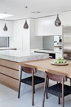 THE DESIGNORY North Bondi House. Featuring custom kitchen joinery with integrated dining table to the island benchtop