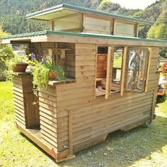 Man in Japan Builds Micro DIY Tiny House on Wheels Micro House on Wheels – I love the pop-up roof section, all the windows, and the all around gorgeousness of this house Tyni House, Tiny House Living, Tiny House Movement, Tiny House Plans, Tiny House On Wheels, Homes On Wheels, Tiny Spaces, Tiny House Design, Little Houses
