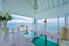 This unique wedding pavilion is surrounded by tropical ocean paradise