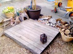 pallet used as an outside 'floor' or base for a small greenhouse, potting shed, etc.