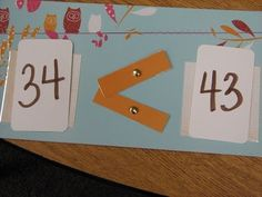 Comparing Numbers. I like the idea of using brads for the alligator mouth so that students can manipulate it.