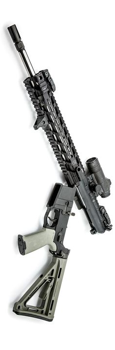 AR-15 setup with Black Hole Weaponry octagon fluted SS barrel, Smith Enterprise Vortex muzzle device, Magpul attire, Aimpoint Comp M4 and Fortis rail. By Stickman.
