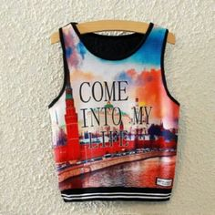 Graphic tank Brand new in plastic. Will not take out of plastic for pictures or model. Sorry tee is displayed in photos above. Tops Crop Tops