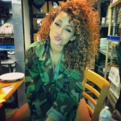 Kayla Phillips Curly Hair & Army Jacket