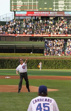 Riccardo Muti, music director of the Chicago Symphony Orchestra, throws out a ceremonial first pitch before the Chicago Cubs take on the Detroit Tigers at Wrigley Field on June 13, 2012 in Chicago, Illinois--The only reason I would go to a Cubs game is to see Muti pitch.
