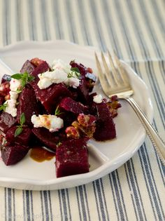 Beet Salad with Walnuts and Goat Cheese  i might be adventurous enough to try it. :)