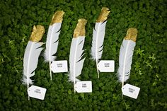 Gold dipped feather wedding placecards...love! From http://ruffledblog.com/regal-whimsy-wedding-ideas/  Photo Credit: http://kayshaweiner.com/