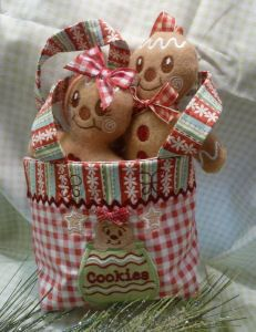 """""""Gingerbread Combo Set"""" comes with designs to create gingerbread boy and girl ornaments, as well as the Ginger Cookie Bag designs! Great for giving a special holiday gift to neighbors, friends & for your decor too!"""