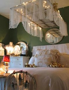 I love that antique window covered in sheer curtain over the bed.
