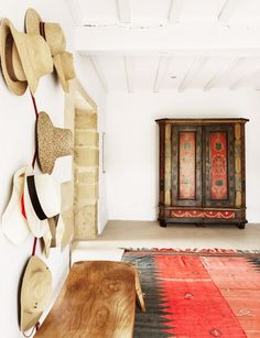 Printed textile rug and ancient printed armoire // via Elle Spain