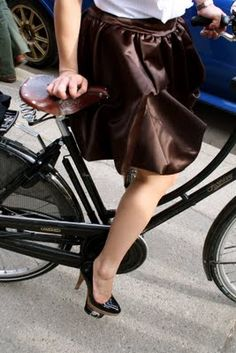 One of my favorite photos of Girls & Bicycle  Love the skirt and shoes... and of course the fact she rides in heels!