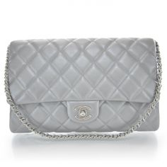 This is an authentic CHANEL Lambskin Quilted Clutch Bag in Silver.   The sophisticated quality and timeless style of this Chanel clutch bag lend a look of classic beauty for day or evening.