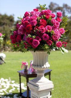 Beautiful urn arrangement... red and deep pink roses with myrtle and salal foilage...just gorgeous!