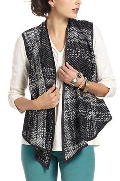 Gosh, is this an easy make on the sewing machine? Just break out the bias tape, such pretty wool yardage, and find yourself a simply vest pattern that dips in the front and go to town with your machine!