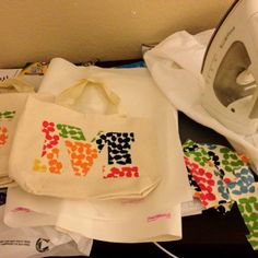 Make and cut out stenciled letters from photoshop. Trace onto fabric. Cut out fabric and heat bond onto canvas bag. Cute to personalize goodie bags for parties.
