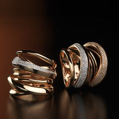 Pink gold ring with diamonds. Pink gold ring with white and brown diamonds.  Soft weavings are born from a golden polished wire. They are enhanced by the light and charm of diamonds.