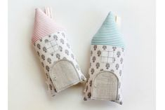 """Gorgeous handmade tooth fairy house pillows on Etsy. The details like a little door with a button """"knob"""" are so lovely."""