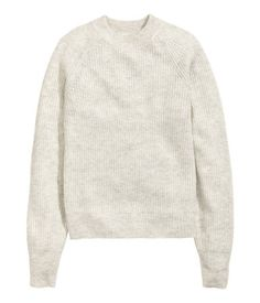 Light gray melange. Soft, rib-knit sweater with wool content. Wide ribbing at…