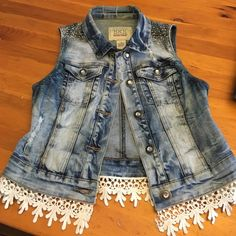 BKE denim vest from the Buckle Cute, cute, cute denim vest from the buckle. The shoulders have little gems on them and the bottom is lined with lace. Super unique and perfect to add a little sass to any spring dress! BKE Jackets & Coats Vests