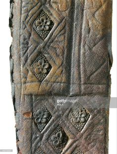 Detail of a medieval leather knife sheath with engraved and stamped rosette and lozenge decoration, from the 1992-2001 excavations at the Merrill Lynch Financial Centre, City of London.