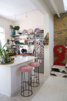 This custom-built island has only the smallest of lips, but it's enough space to accommodate these quirky, cushy stools.   Kitchen Island Breakfast Bar Ideas & Inspiration | Apartment Therapy