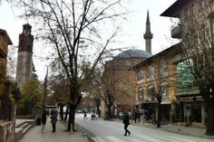 The clock tower and a mosque in Pristina's old quarter. Image by Larissa Olenicoff / Lonely Planet