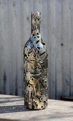 Wine Key Bottle Metal Sculpture by Moerkey on Etsy Very cool. He makes other things from keys, copper wire, pennies.Red Wine Key Bottle Metal Sculpture by Moerkey on Etsy Very cool. He makes other things from keys, copper wire, pennies. Wine Bottle Art, Wine Bottle Crafts, Diy Bottle, Bottle Vase, Beer Bottle, Bottle Opener, Metal Tree Wall Art, Metal Art, Wine Key