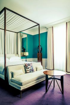 Bright purple carpet, turquoise walls and canopy beds truly make the J.K. Place in #Rome, #Italy a unique and unforgettable stay for their guests and makes our Best Up-and-Coming Hotels list!