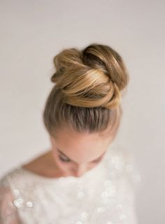 Top knot. Wedding hairstyles. Sophisticated up do. Jenny Packham Rose Wedding Dress